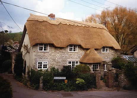 Rethatched house in combed wheat reed, Osmington Dorset